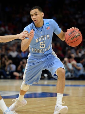 North Carolina Tar Heels guard Marcus Paige (5) moves the ball against Wisconsin Badgers during the first half in the semifinals of the west regional of the 2015 NCAA Tournament at Staples Center.
