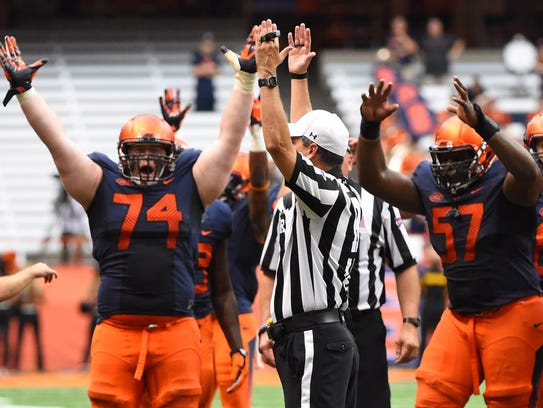 Syracuse celebrates a winning touchdown in overtime