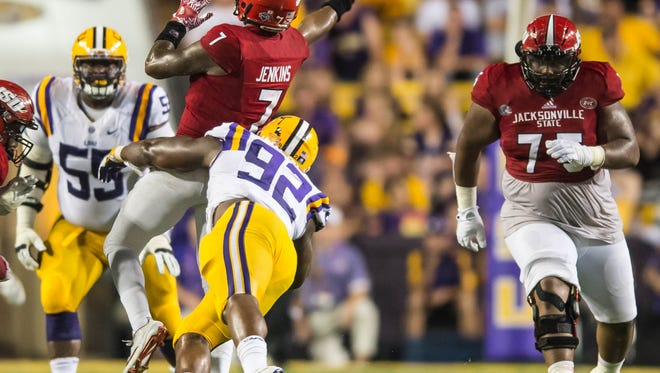 Advertiser photo by Buddy Delahoussaye-- LSU Tigers defensive end Lewis Neal (92) puts the hit on the Gamecocks quarterback that causes the interception on Saturday September 10, 2016.