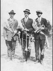 Three young Stuart fellows were part of the new flagpole and flag-raising ceremony on Feb. 22, 1916, in front of the schoolhouse. Patriotic in dress, and musical instruments in hand, were Jack McDonald (from left) 16, Darrel Smith, 16, and Leeson Hogarth, 15.