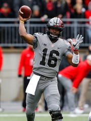 Ohio State quarterback J.T. Barrett throws a pass against