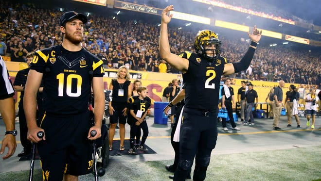 ASU quarterback Mike Bercovici (2) alongside injured quarterback Taylor Kelly on crutches prior to the game against the UCLA Bruins at Sun Devil Stadium.