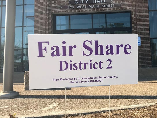 A sign place by Councilwoman Sherri Myers stands in
