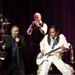 Ralph Johnson, Verdine White and Philip Bailey of Earth, Wind and Fire perform a benefit concert for the Duke Ellington School of the Arts at the John F. Kennedy Center for the Performing Arts on February 24, 2011 in Washington, DC.