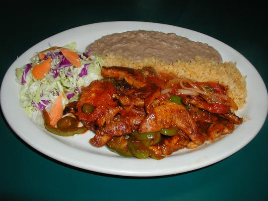 The most popular item on the Vallarta Restaurant menu is pollo Veracruz chicken breast strips cooked with slices of tomato, bell pepper, jalapenos, onions and olives and plated with beans, rice and salad. Tell the server how mild or spicy you'd like.