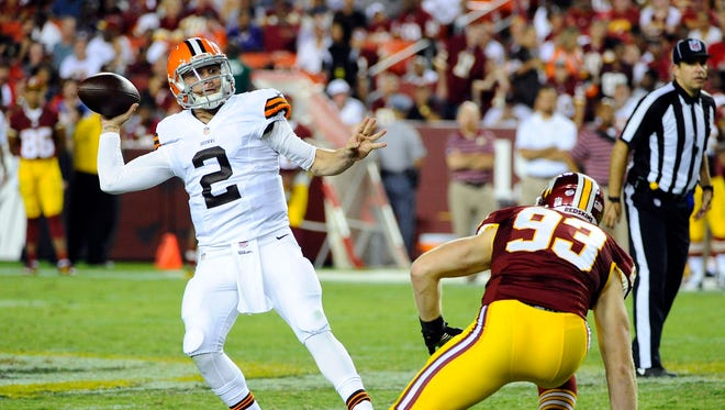 Cleveland Browns quarterback Johnny Manziel (2) throws a pass as Washington Redskins linebacker Trent Murphy (93) pressures during the second half at FedEx Field.