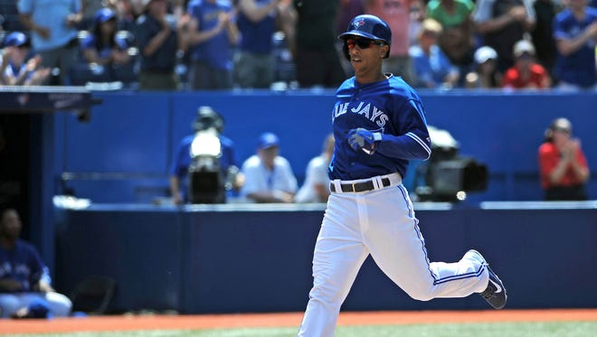 Toronto Blue Jays pinch hitter Anthony Gose scores in the ninth inning of the Jays 4-3 loss to Chicago White Sox  at Rogers Centre.