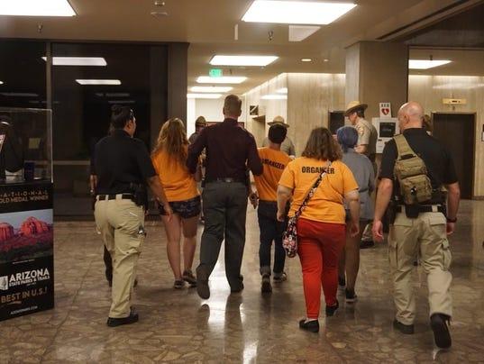 DPS escorts students our Arizona Executive Tower