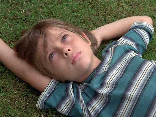 Ellar Coltrane, here at age 6, grows up on screen during
