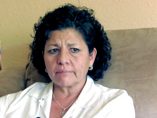 In this July 14, 2015 file photo from video, Tina Cordova talks of her late father, Anastacio Cordova, who she believes died after suffering from multiple bouts of cancer possibly provoked by his childhood near the atomic bomb Trinity Test in Tularosa New Mexico.