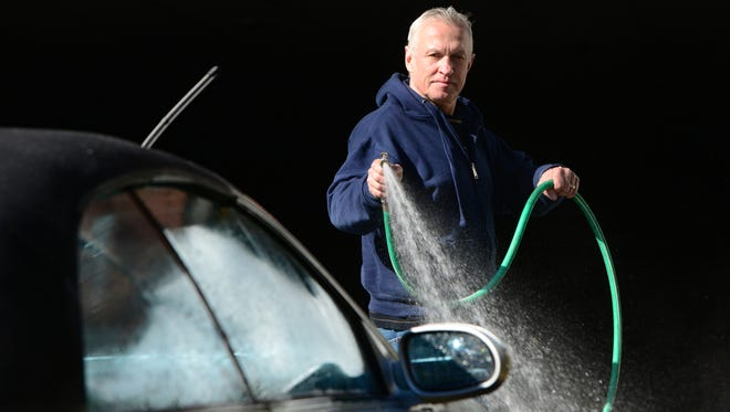 Chris Gratka washing his friend's car on Union St. in Ridgewood Thursday morning.