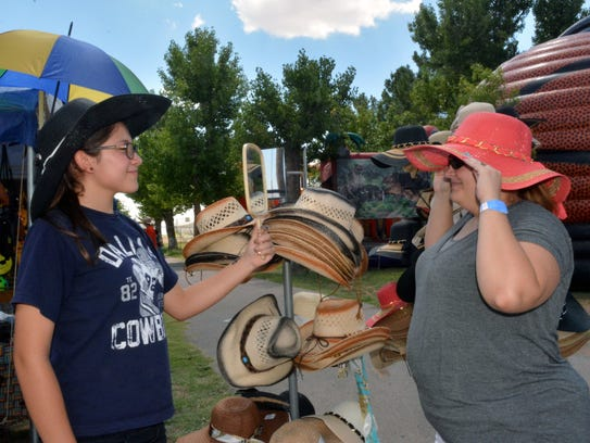 Jaclyn Lopez, left, helps Tami Smith pick a hat  at