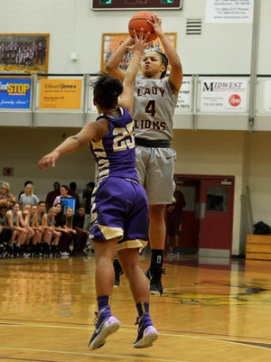 Freed-Hardeman's Taleeah Cross pulls up for a shot over Bethel's Shamon Pearson during their game Tuesday evening at FHU.