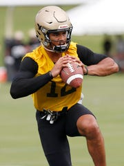 Quarterback Jared Sparks in passing drill during Purdue