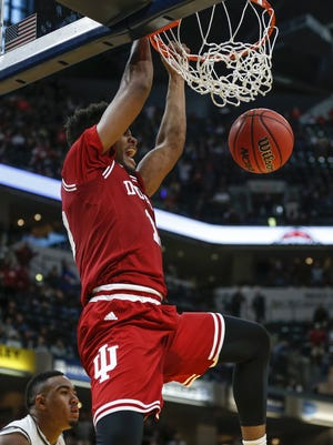 Indiana Hoosiers forward Juwan Morgan (13) dunks for the go-ahead score over Notre Dame Fighting Irish in overtime during the Crossroads Classic at Bankers Life Fieldhouse in Indianapolis on Saturday, Dec. 16, 2017.