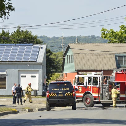 Ithaca police and firefighters are staged on Cherry Street in the city Wednesday afternoon.