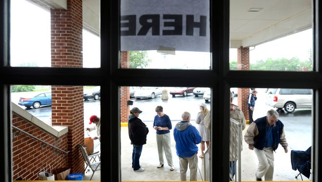 Candidate supporters and voters are seen at a polling place at Aldersgate United Methodist Church. Bill Kalina photo