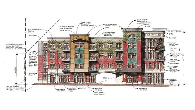 An artist's rendering from November 2014 depicting a proposed four-story building at 300 W. Grand River Ave. in East Lansing, near Delta Street and Valley Court Park. Lansing Township-based rental housing developer DTN Management Co. is proposing to build the project, which will contain 39 two-bedroom apartments and ground-floor retail space.