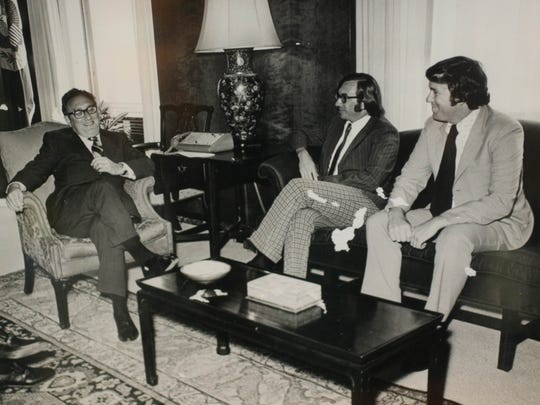 Ken Quinn, right, sits with Henry Kissinger, left, the U.S. secretary of state from 1973 to 1977. This photo hangs on the wall in Quinn's office at the World Food Prize building in Des Moines.