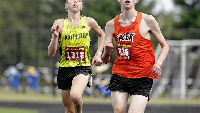 Senior Charlie Nowinski (left) established himself as the top runner for the boys cross country team, which was runner-up in the OCC-Central Division and district 2 meets last year.