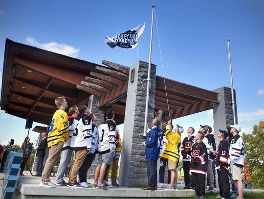 St. Cloud high school hockey players gather around