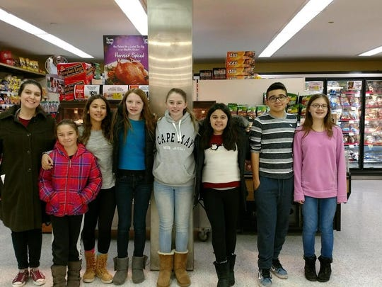 Netcong School chorus students at ShopRite. Pictured from left to right are Ava Zajaczkowski, Mia Santana, Ciara Mulroy, Tara Charette, Emma Theriault, Christopher Mejia, Kyla Renegar.