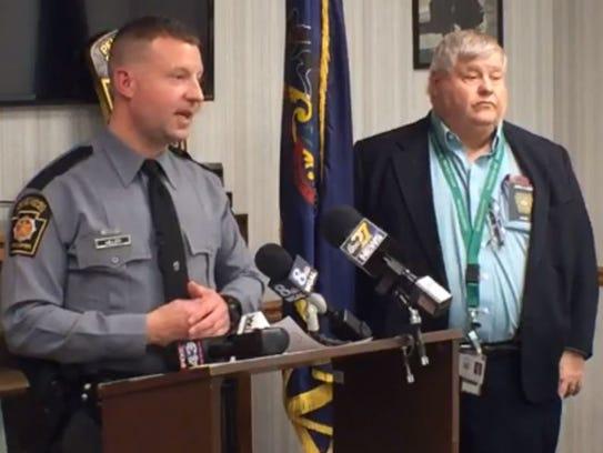 Trooper Brent Miller and county coroner Jeff Conner,