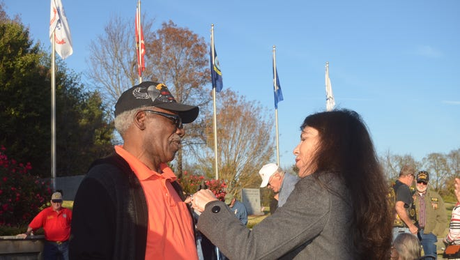 Vietnam veteran Dallas Trotty receives a pin commemorating the 50-year anniversary of the war's end from Gallatin Mayor Paige Brown Friday during an event at the Sumner County Veterans Park.