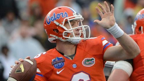 Florida quarterback Jeff Driskel (6) throws a pass during the first half of the Birmingham Bowl NCAA college football game against East Carolina, Saturday, Jan. 3, 2015, in Birmingham, Ala. (AP Photo/ AL.com, Mark Almond)