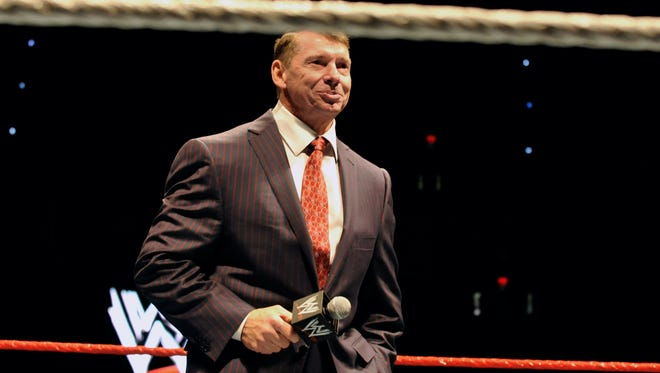 "FILE - In this Oct. 30, 2010 file photo, WWE chairman and CEO Vince McMahon speaks to an audience during a WWE fan appreciation event in Hartford, Conn.   WWE's 'Raw' set out to be a special kind of wrestling show from its birth on Jan. 11, 1993. ""Welcome everyone, to Monday Night Raw!"" McMahon bellowed. ""We are live from New York City!"" The WWE will celebrate the 25th anniversary of ""Raw"" on Jan. 22 at its original home of the Manhattan Center with some of the biggest stars in the company's history stopping by for a fight."