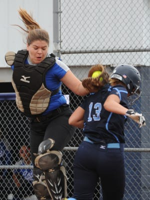 Chillicothe's Haylee Jo Large tags Adena's Kaitlyn Davis Thursday at Adena High School. The Cavaliers defeated the Warriors 13-8.