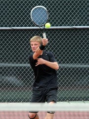 Washington's Elliot Hartwig plays doubles during the