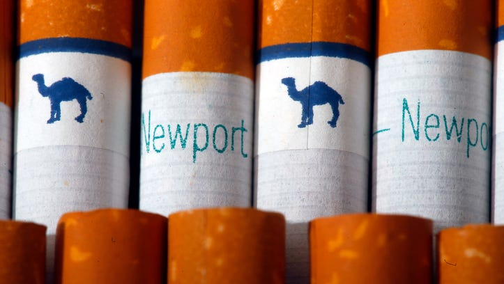 Camel, a Reynolds American brand, and Newport, a Lorillard brand, cigarettes are arranged for a photo Tuesday, July 15, 2014 in Philadelphia. Reynolds American Inc. is planning to buy rival Lorillard Inc. for about $25 billion in a deal to combine two of the nation's oldest and biggest tobacco companies.
