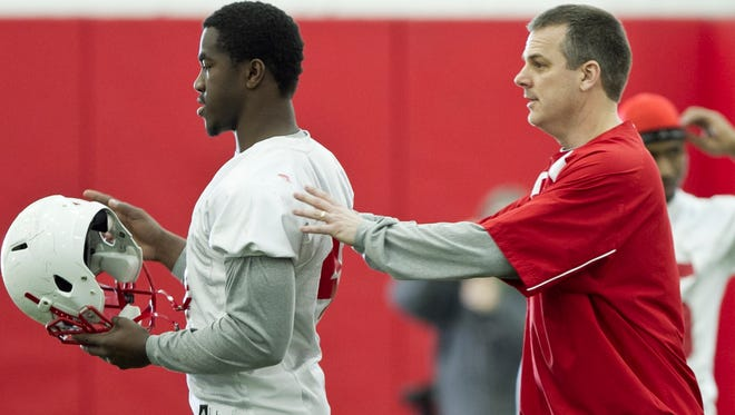 Nebraska linebackers coach Ross Els, right, works with linebacker Lavonte David on the first day of spring NCAA college football practice in Lincoln, Neb., Saturday, March 12, 2011. (AP Photo/Nati Harnik)