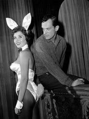 Hugh Hefner poses with Playboy Club hostess Bonnie