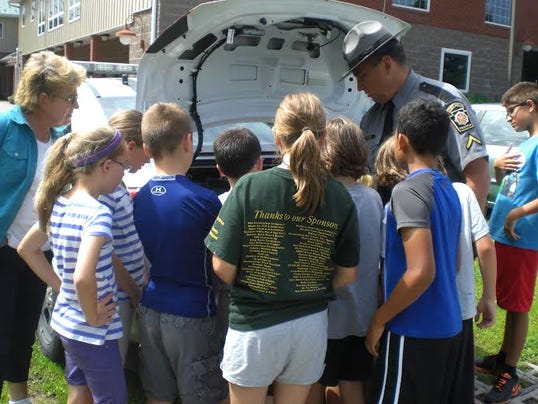Twelve children from the surrounding area had a blast learning about forensic scientists and the jobs that they do.