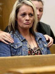Shawna Slover is comforted during the sentencing of her son, Andrew Slover, 24, of Salem, at the Marion County Courthouse in downtown Salem on Thursday, April 23, 2015. Slover was sentenced to life in prison, with the eligibility for parole after 25 years, for murder and first-degree robbery.