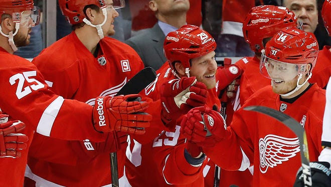 Red Wings right wing Gustav Nyquist (14) celebrates his goal against the Sharks in the second period Saturday at Joe Louis Arena.