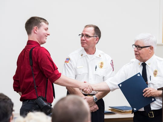 Harrison Jones is awarded the Letter of Recognition of Services during the Hanover Area Fire and Rescue commendation awards ceremony at the Penn Township Municipal Center on June 21, 2018.