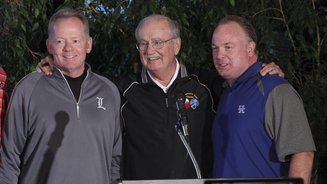 U of L head football coach Bobby Petrino, left, and UK head football coach Mark Stoops, right, posed with emcee Billy Reed before they addressed the crowd during the Governor's Cup ceremony at the Frankfort Country Club. June 3, 2015