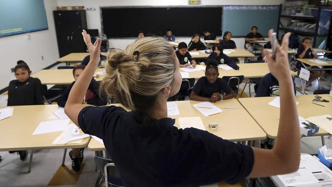 In this Friday, July 13, 2018 photo, teacher Zara Gibbon gestures while teaching a group of incoming sixth-graders at Animo Westside Charter Middle School during a summer session to introduce new students to the school they will attend in the fall, in the Playa Del Rey area of Los Angeles. Animo is one of many schools to benefit from donations by billionaires that are influencing state education policy by giving money to state-level charter support organizations to sustain, defend and expand the charter schools movement across the country. (AP Photo/Reed Saxon)