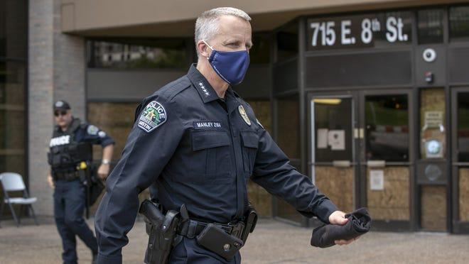 Austin Police Chief Brian Manley walks outside police headquarters after he and other officers kneeled for 8 minutes and 46 seconds in memory of George Floyd during a June 6 protest.