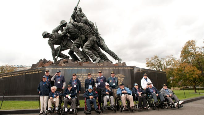 World War II veterans from the Hudson Valley Honor Flight pose in front of the Marine Corps War Memorial on Oct. 18, 2014.