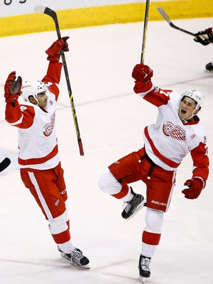 Red Wings center Dylan Larkin, right, celebrates his goal against the Coyotes with Andreas Athanasiou during the first period Thursday, March 16, 2017 in Glendale, Ariz.