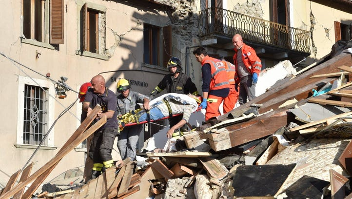 Rescuers clear debris while searching for earthquake