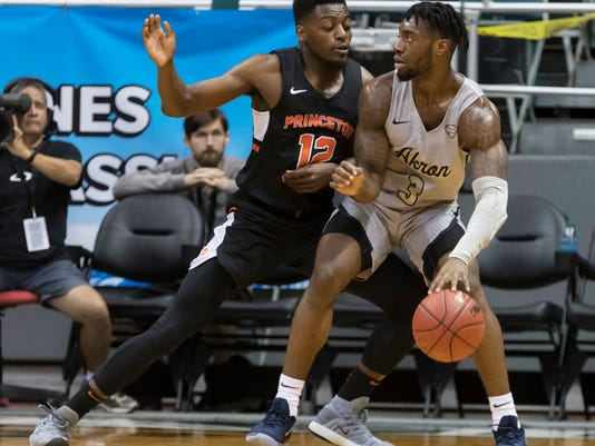 Akron forward Daniel Utomi (3) post up to Princeton guard Myles Stephens (12) during the first half of an NCAA college basketball game at the Diamond Head Classic tournament, Saturday, Dec. 23, 2017, in Honolulu. (AP Photo/Eugene Tanner)