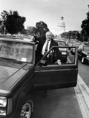 """Rep. John Dingell checks out a new Jeep Cherokee Sport at the """"Drive American Quality"""" exhibit at the Mall in Washington, May 25, 1993."""