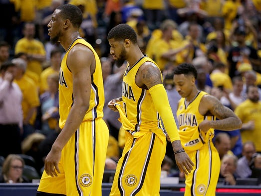 Dejected Indiana PacersThaddeus Young (21), Paul George