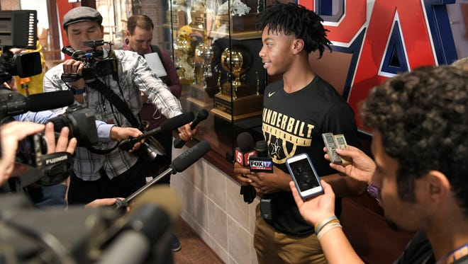 Brentwood Academy basketball star Darius Garland speaks to the media at a press conference to announce his college decision Monday.