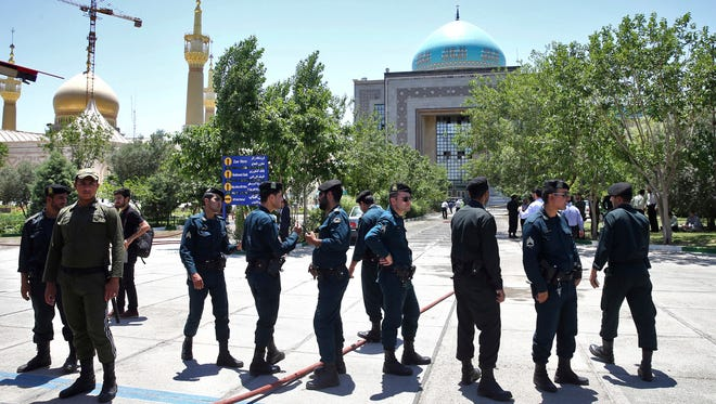 Police officers guard the shrine of late Iranian revolutionary founder Ayatollah Khomeini after an attack in Tehran on June 7, 2017.